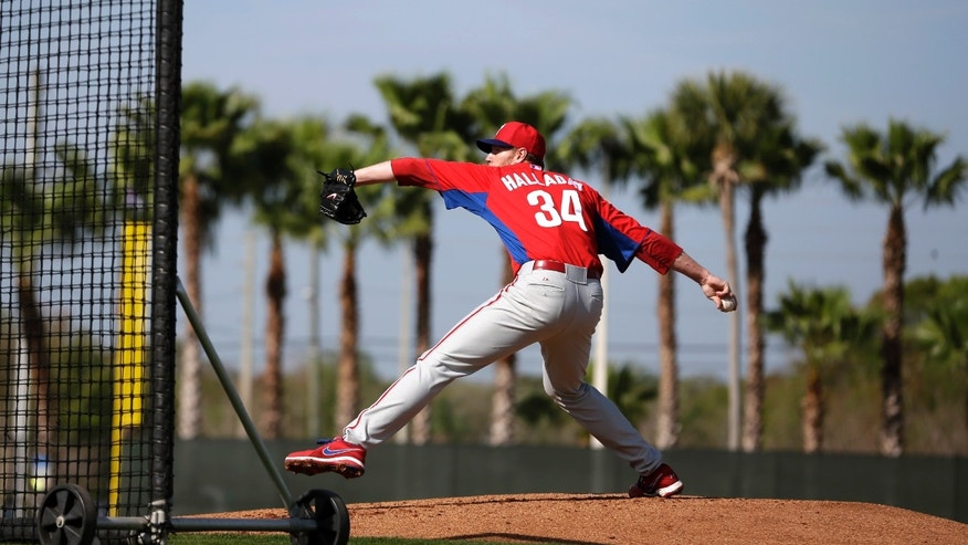 Philadelphia Phillies' Roy Halladay pitches batting practice during a workout at baseball spring training, Thursday, Feb. 21, 2013, in Clearwater, in Fla. (AP Photo/Matt Slocum)
