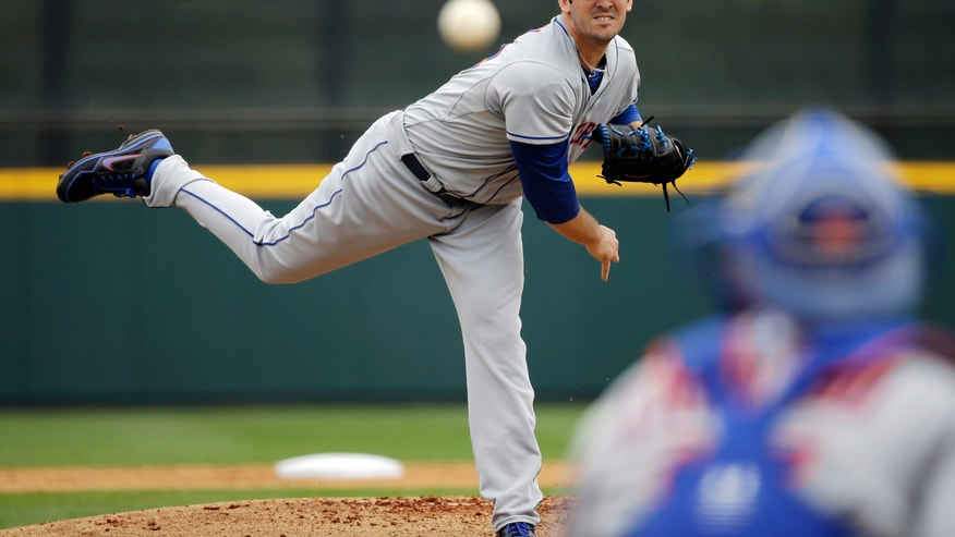 New York Mets pitcher Matt Harvey throws against the Houston Astros during the first inning of an exhibition spring training baseball game, Sunday, Feb. 24, 2013, in Kissimmee, Fla. (AP Photo/David J. Phillip)