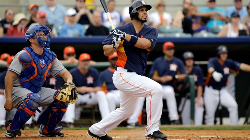 Houston Astros' Fernando Martinez, right, follows the flight of his home run as New York Mets catcher Travis d'Arnaud, left, watches during the second inning of an exhibition spring training baseball game, Sunday, Feb. 24, 2013, in Kissimmee, Fla. (AP Photo/David J. Phillip)