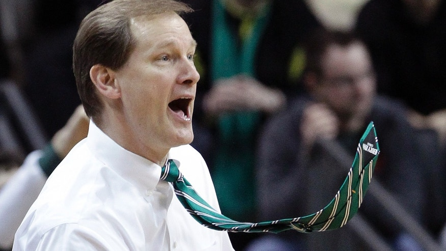 Oregon coach Dan Altman's tie flies as he yells from the bench during the second half of an NCAA college basketball game against Stanford in Eugene, Ore., Saturday, Feb. 23, 2013. (AP Photo/Don Ryan)