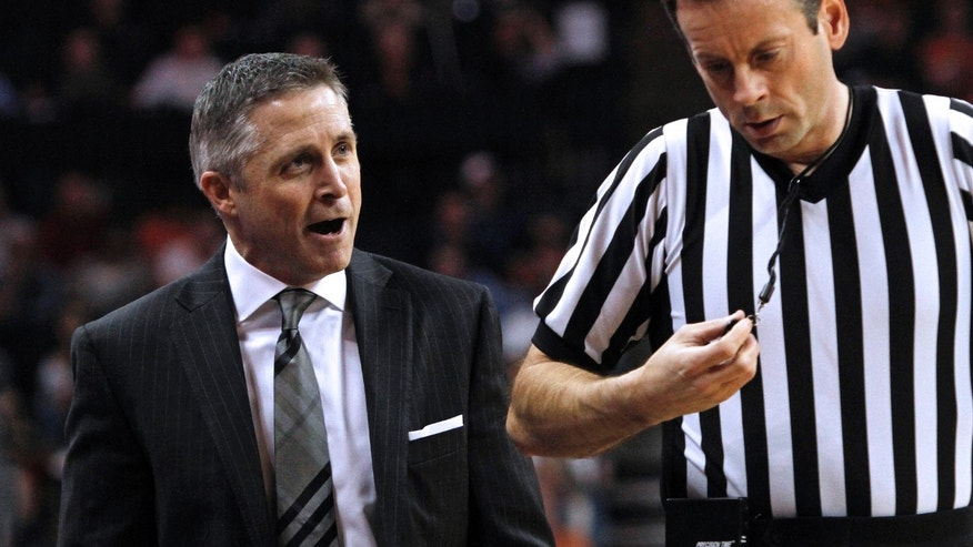 Georgia Tech head coach Brian Gregory argues with an official in the first half of an NCAA college basketball game in Charlottesville, Va., Sunday, Feb. 24, 2013. (AP Photo/Norm Shafer)