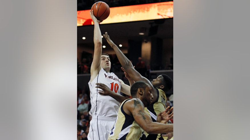 Virginia's Mike Tobey shoots over Georgia Tech forward Robert Carter Jr. in the first half of an NCAA college basketball game in Charlottesville, Va., Sunday, Feb. 24, 2013. (AP Photo/Norm Shafer)