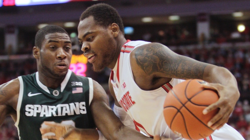 Ohio State's Deshaun Thomas, right, drives to the basket against Michigan State's Branden Dawson during the first half of an NCAA college basketball game Sunday, Feb. 24, 2013, in Columbus, Ohio. (AP Photo/Jay LaPrete)