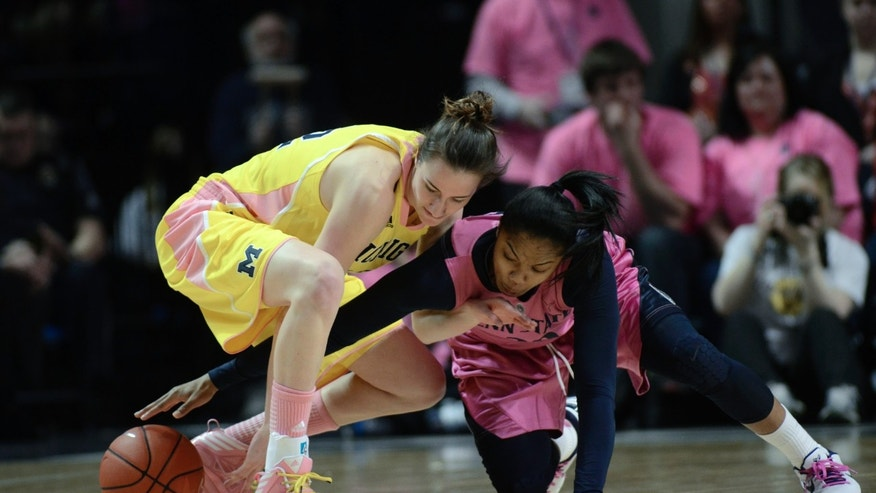 Penn State's Alex Bentley (20) reaches in for a loose ball around Michigan's Kate Thompson (12) during the first half of an NCAA college basketball game in State College, Pa., Sunday, Feb. 24, 2013. (AP Photo/Ralph Wilson)