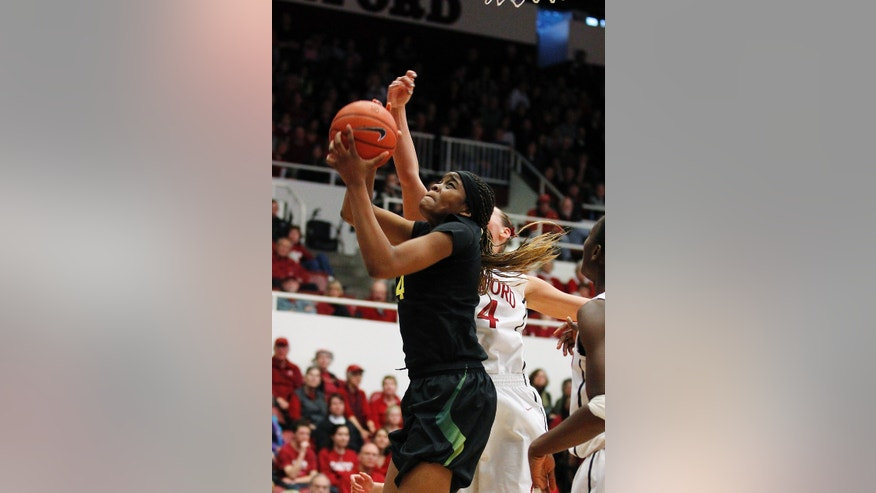 Oregon forward Jillian Alleyne (14) drives to the basket against Stanford forward Joslyn Tinkle (44) during the second half of an NCAA college basketball game in Stanford, Calif., Sunday, Feb. 24, 2013. Stanford won 74-50. (AP Photo/Tony Avelar)