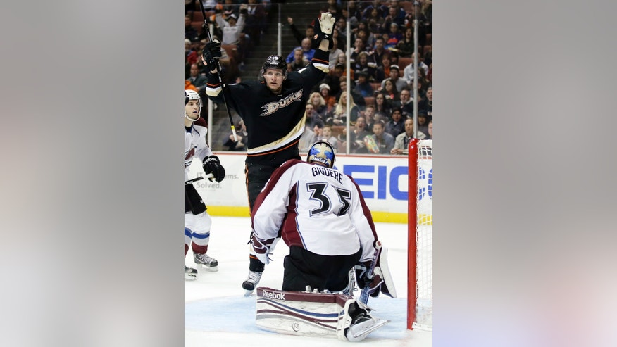 Anaheim Ducks right wing Corey Perry, rear, celebrates his goal past Colorado Avalanche goalie Jean-Sebastien Giguere during the second period of an NHL hockey game in Anaheim, Calif., Sunday, Feb. 24, 2013. (AP Photo/Chris Carlson)