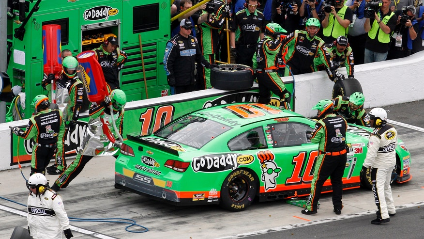 Danica Patrick pits for fuel and tires during the NASCAR Daytona 500 Sprint Cup Series auto race at Daytona International Speedway, Sunday, Feb. 24, 2013, in Daytona Beach, Fla. (AP Photo/David Graham)