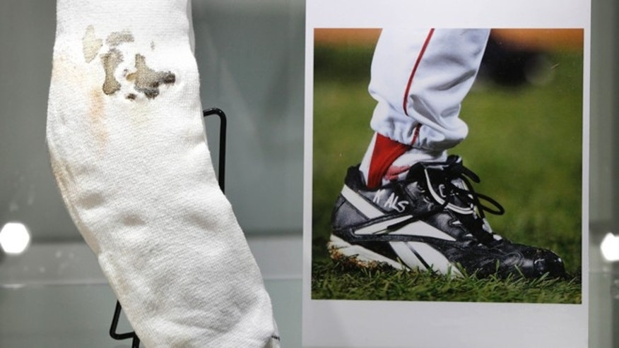 Feb. 21, 2013: The bloody sock worn by former Boston Red Sox pitcher Curt Schilling in Game 2 of the 2004 World Series is displayed at Heritage Auctions in New York.