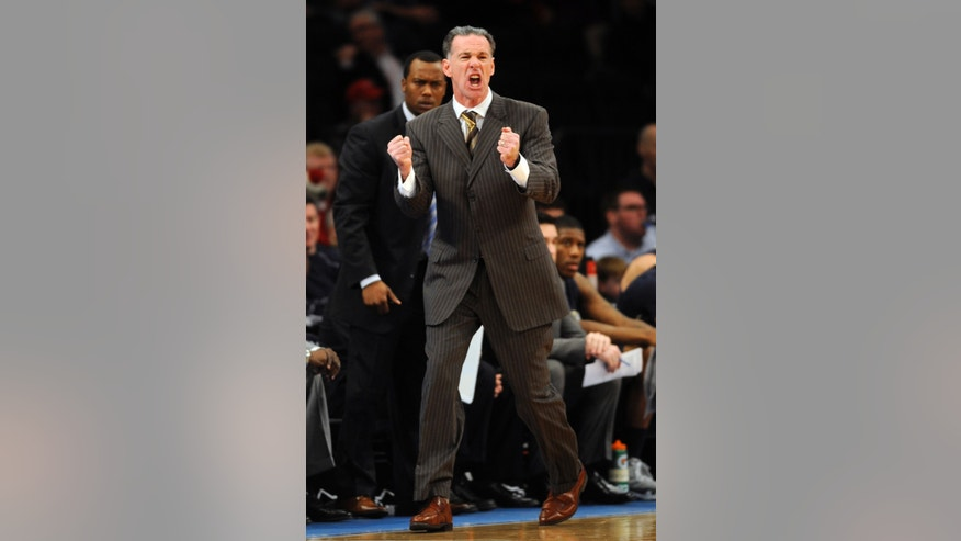 Pittsburgh coach Jamie Dixon shouts during first half of the NCAA college basketball game against St. John's at Madison Square Garden in New York, Sunday, Feb. 24, 2013. Pitt won 63-47. (AP Photo/Henny Ray Abrams)