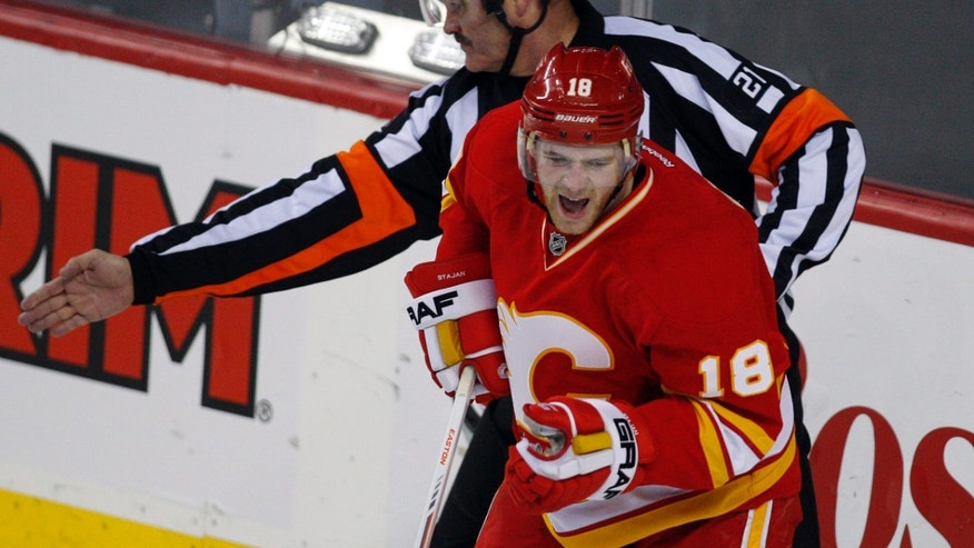 Calgary Flames' Matt Stajan, right, celebrates his game-winning goal during the third period of an NHL hockey game against the Minnesota Wild in Calgary, Alberta, Saturday, Feb. 23, 2013. (AP Photo/The Canadian Press, Jeff McIntosh)