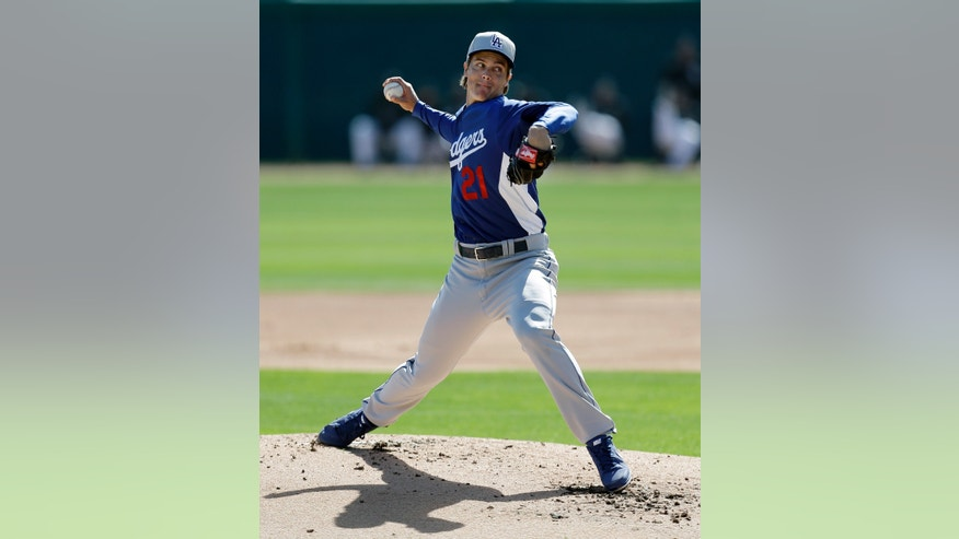 Los Angeles Dodgers pitcher Zack Greinke throws against the Chicago White Sox in the first inning of a exhibition spring training baseball game in Glendale, Ariz., Sunday, Feb. 24, 2013. (AP Photo/Paul Sancya)
