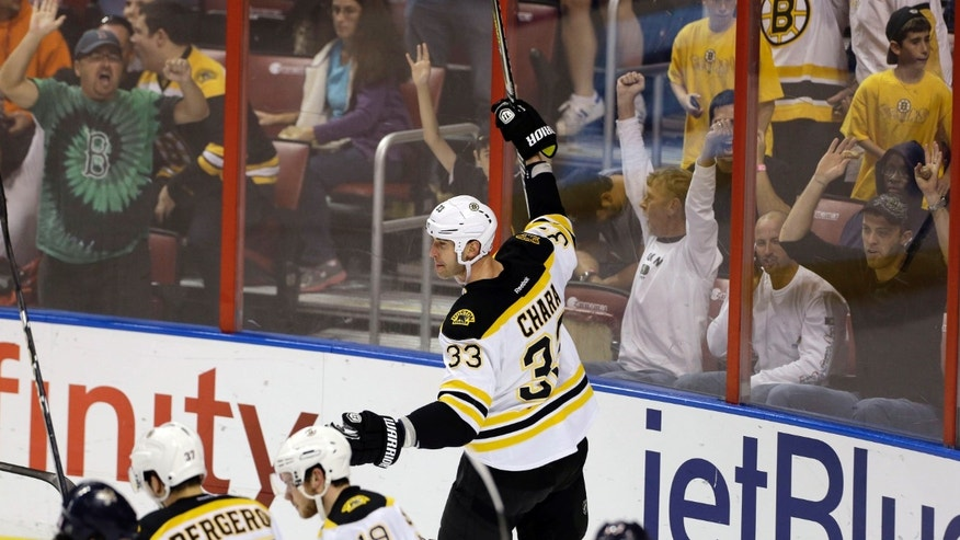 Fans react after Boston Bruins' Zdeno Chara (33) scored a goal against the Florida Panthers during the first period of an NHL hockey game in Sunrise, Fla., Sunday, Feb. 24, 2013. (AP Photo/J Pat Carter)
