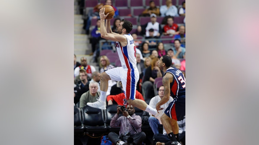 Detroit Pistons guard Jose Calderon (8) of Spain makes a layup during the first quarter of an NBA basketball game against the Atlanta Hawks at the Palace in Auburn Hills, Mich., Monday, Feb. 25, 2013. (AP Photo/Carlos Osorio)