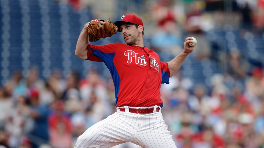 Philadelphia Phillies' Cliff Lee pitches during the first inning of a spring training exhibition baseball game against the Detroit Tigers, Monday, Feb. 25, 2013, in Clearwater, Fla.  (AP Photo/Matt Slocum)