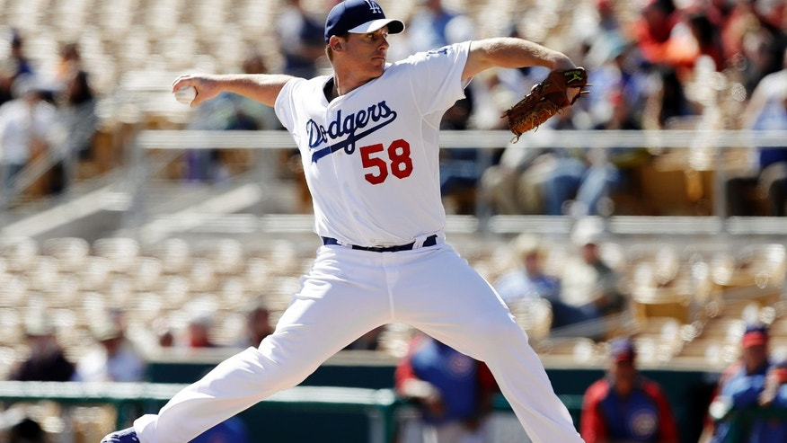 Los Angeles Dodgers pitcher Chad Billingsley throws against the Chicago Cubs in the first inning of an exhibition spring training baseball game in Glendale, Ariz., Monday, Feb. 25, 2013. (AP Photo/Paul Sancya)