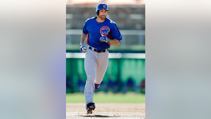 Chicago Cubs' Nate Schierholtz rounds the bases after hitting a solo home run against the Los Angeles Dodgers in the first inning of an exhibition spring training baseball game in Glendale, Ariz., Monday, Feb. 25, 2013. (AP Photo/Paul Sancya)