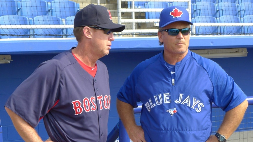 Former Toronto Blue Jays third base coach Brian Butterfield, now with Boston, left,  reminisces with Toronto manager John Gibbons prior to an exhibition spring training baseball game in Dunedin, Fla., Monday, Feb. 25, 2013. (AP Photo/The Canadian Press, Neil Davidson)