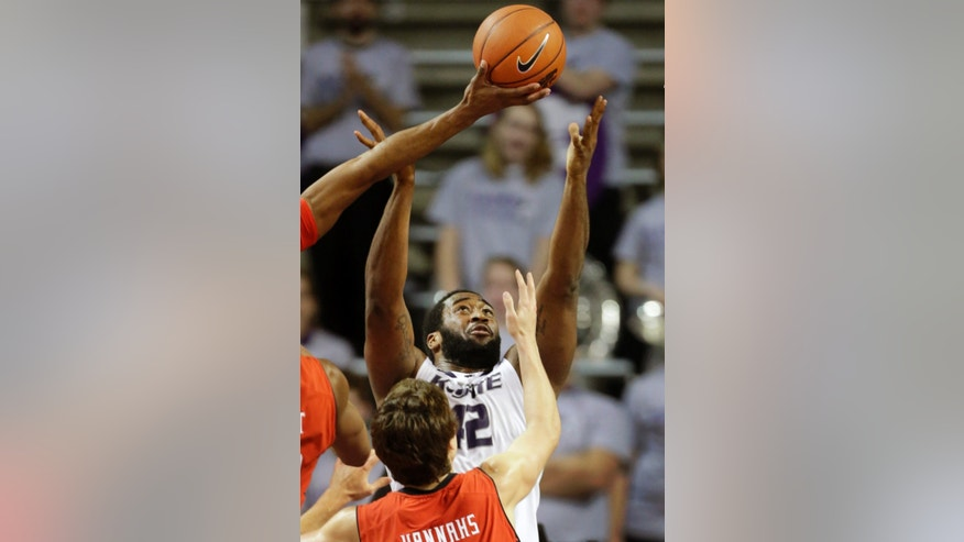 Kansas State forward Thomas Gipson (42) battles for a rebound over Texas Tech guard Dusty Hannahs (2) during the first half of an NCAA college basketball game in Manhattan, Kan., Monday, Feb. 25, 2013. (AP Photo/Orlin Wagner)