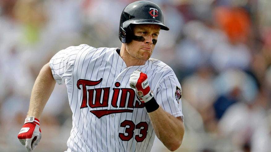 Minnesota Twins' Justin Morneau runs after hitting bases loaded double to bring in three runs in the fourth inning of an exhibition spring training baseball game against the Pittsburgh Pirates, Monday, Feb. 25, 2013, Fort Myers, Fla. (AP Photo/David Goldman)