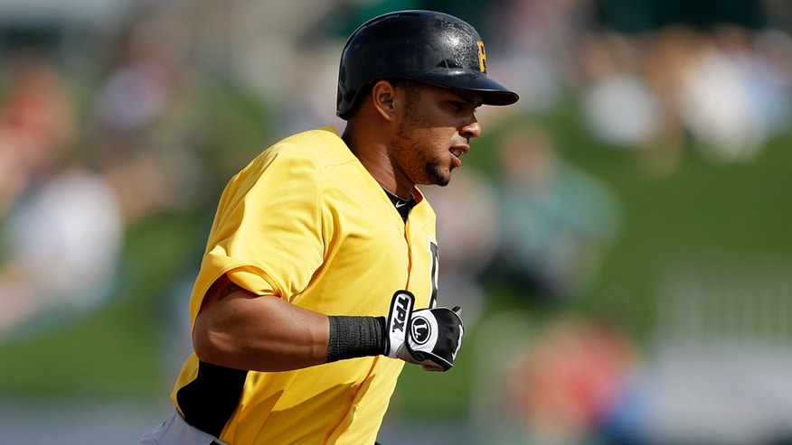 Pittsburgh Pirates' Jose Tabata rounds the bases after hitting a home run in the seventh inning of an exhibition spring training baseball game against the Minnesota Twins, Monday, Feb. 25, 2013, Fort Myers, Fla. Minnesota won 5-4. (AP Photo/David Goldman)