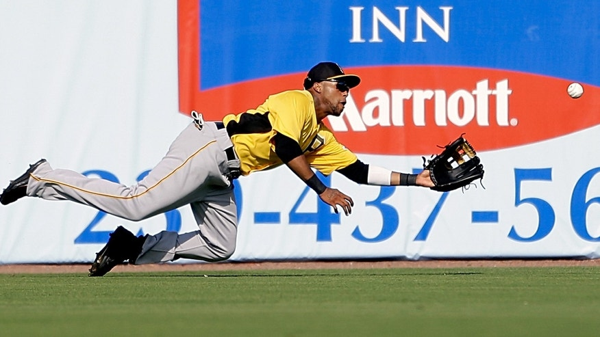 Pittsburgh Pirates center fielder Darren Ford dives unsuccessfully for a fly ball hit by Minnesota Twins' Chris Colabello allowing Brandon Boggs to score in the eighth inning of an exhibition spring training baseball game, Monday, Feb. 25, 2013, Fort Myers, Fla. Minnesota won 5-4. (AP Photo/David Goldman)