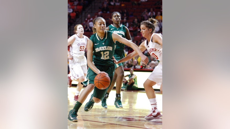 Baylor guard Alexis Prince (12) drives to the basket around Oklahoma guard Morgan Hook (10) during the first half of a NCAA Women's basketball game in Norman, Monday, Feb. 25, 2013.  (AP Photo/Alonzo Adams)