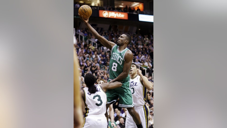 Boston Celtics' Jeff Green (8) goes to the basket as Utah Jazz's DeMarre Carroll (3) and Enes Kanter (0) defend in the second quarter during an NBA basketball game, Monday, Feb. 25, 2013, in Salt Lake City. (AP Photo/Rick Bowmer)