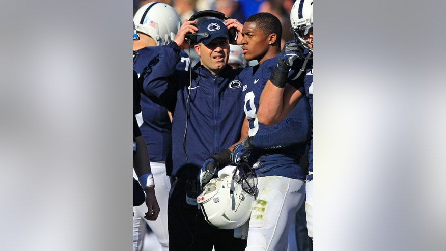 FILE - In this Nov. 17, 2012, file photo, Penn State wide receiver Allen Robinson (8) talks with head coach Bill O'Brien during a time out in the third quarter of an NCAA college football game in State College, Pa. Robinson is growing familiar with O'Brien's expectations. And like other veteran players, he's helping the team's new arrivals get used to the offseason weight program. (AP Photo/Gene J. Puskar, File)
