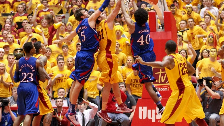 Kansas center Jeff Withey (5) and forward Kevin Young (40) try to keep a rebound away from Iowa State forward Georges Niang (31) late in the second half of an NCAA college basketball game Monday, Feb. 25, 2013, at Hilton Coliseum in Ames, Iowa. Kansas won the game 108-96 in overtime. (AP Photo/Justin Hayworth)