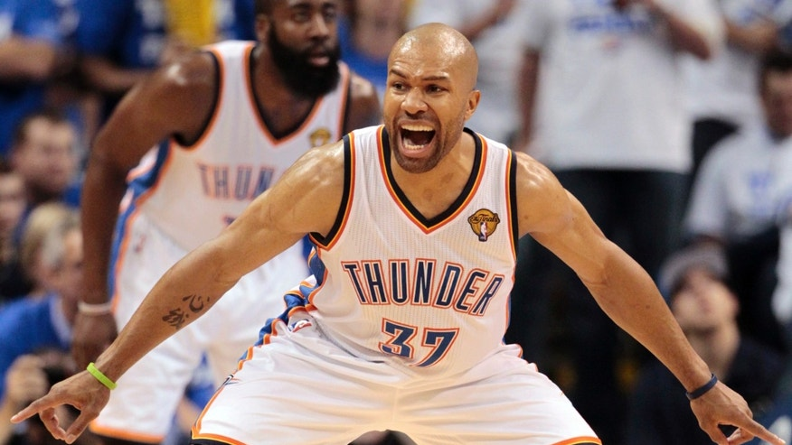 FILE - In this June 14, 2012 file photo, Oklahoma City Thunder point guard Derek Fisher (37) shouts during the first half at Game 2 of the NBA finals basketball series against the Miami Heat in Oklahoma City. The Thunder signed veteran Derek Fisher on Monday, Feb. 25, 2013, filling an opening for a third point guard that was created when Eric Maynor got traded to Portland. (AP Photo/Jeff Roberson, FIle)