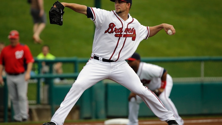 Atlanta Braves pitcher Mike Minor throws during the first inning of an exhibition spring training baseball game against the Washington Nationals Tuesday, Feb. 26, 2013, in Kissimmee, Fla. (AP Photo/David J. Phillip)