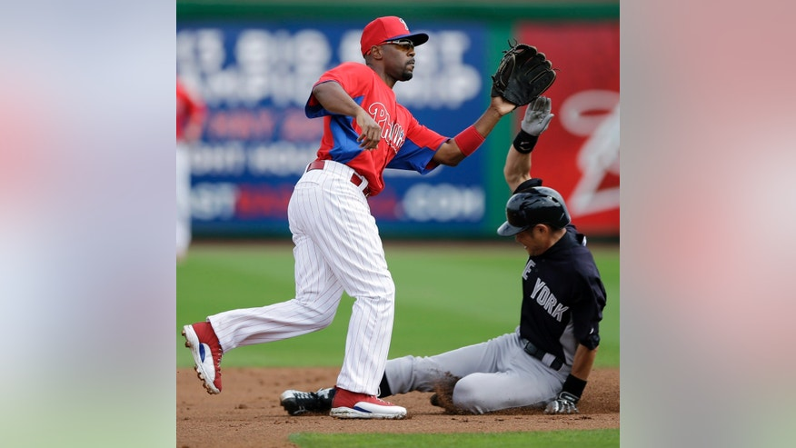 New York Yankees' Ichiro Suzuki, right, of Japan, steals second base as Philadelphia Phillies' Jimmy Rollins fields the throw from home during the first inning of an exhibition spring training baseball game, Tuesday, Feb. 26, 2013, in Clearwater, Fla. (AP Photo/Matt Slocum)