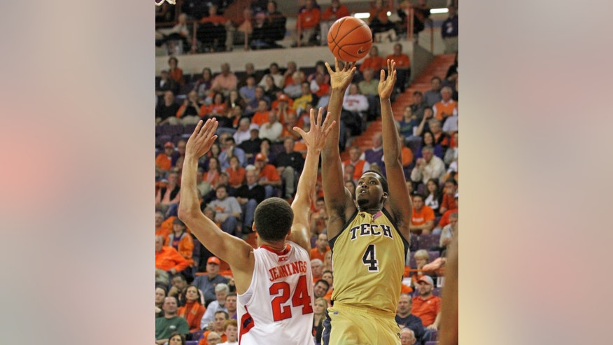 FILE - In this Jan. 29, 2013 file photo, Georgia Tech's Robert Carter, Jr., right, shoots over Clemson's Milton Jennings in an NCAA college basketball game in Clemson, S.C. Georgia Tech, which plays Maryland on Wednesday night, Feb. 27, 2013, +is the only team in the ACC whose top scorer is a freshman. In fact, Georgia Tech's top two scorers _ Marcus Georges-Hunt and Robert Carrter Jr. _ are freshmen. (AP Photo/Anderson Independent-Mail, Mark Crammer, File) GREENVILLE OUT  SENECA OUT