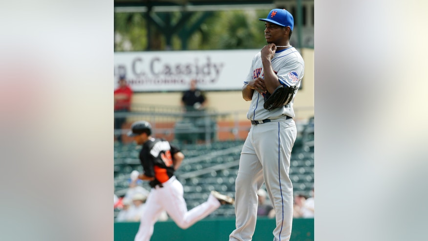 New York Mets relief pitcher Jenrry Mejia, right, stand on the mound after giving up a three-run home run to Miami Marlins non-roster invitee Casey Kotchman, background, during the first inning of an exhibition spring training baseball game, Tuesday, Feb. 26, 2013, in Jupiter, Fla. (AP Photo/Julio Cortez)