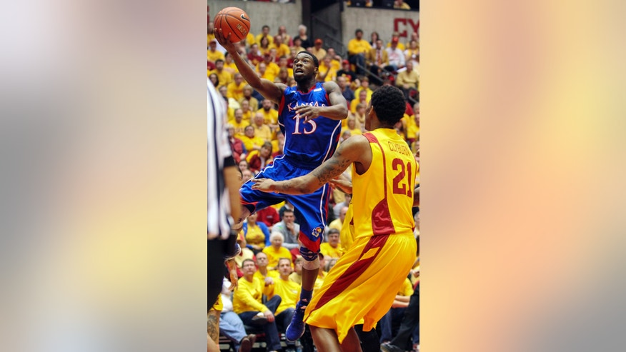 Kansas guard Elijah Johnson (15) shoots against Iowa State's Will Clyburn (21) during the first half of an NCAA college basketball game, Monday, Feb. 25, 2013, in Ames, Iowa. Johnson scored 39 points in their 108-96 overtime win. (AP Photo/Justin Hayworth)