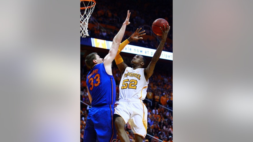 Tennessee guard Jordan McRae (52) shoots over Florida center Erik Murphy (33) in the first half of an NCAA college basketball game against Florida on Tuesday, Feb. 26, 2013, in Knoxville, Tenn. (AP Photo/Wade Payne)