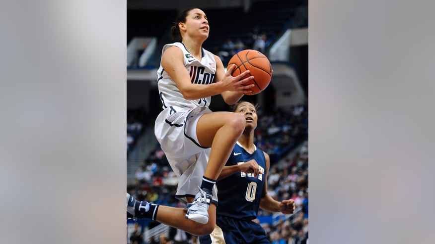 Connecticut's Bria Hartley, left, drives to the basket as Pittsburgh's Asia Logan, right, defends during the first half of an NCAA college basketball game in Hartford, Conn., Tuesday, Feb. 26, 2013. (AP Photo/Jessica Hill)