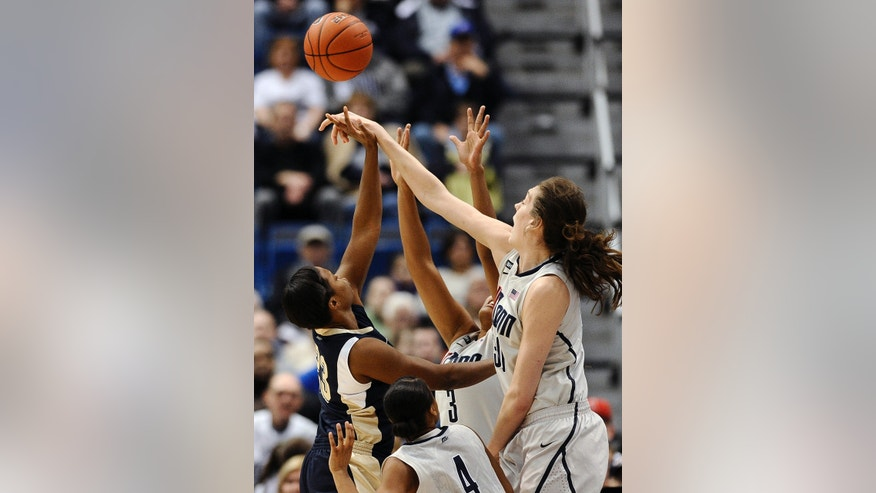 Connecticut's Breanna Stewart, right, blocks a shot by Pittsburgh's Ashlee Anderson, left, as Connecticut's Moriah Jefferson (4) and Morgan Tuck (3) defend during the first half of an NCAA college basketball game in Hartford, Conn., Tuesday, Feb. 26, 2013. (AP Photo/Jessica Hill)