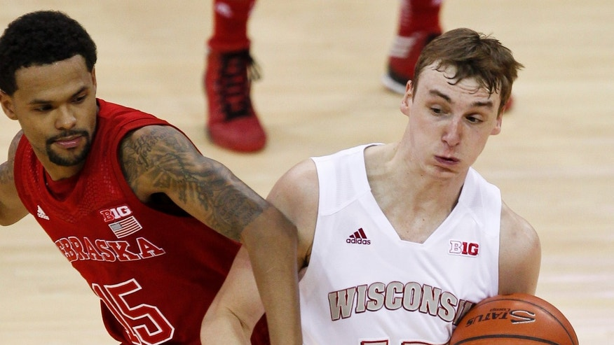 Wisconsin's Sam Dekker, right, steals the ball from Nebraska's Ray Gallegos during the first half of an NCAA college basketball game Tuesday, Feb. 26, 2013, in Madison, Wis. (AP Photo/Andy Manis)