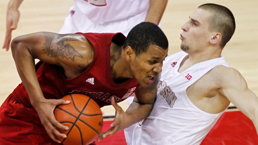 Nebraska's Dylan Talley, left, fouls Wisconsin's Ben Brust during the first half of an NCAA college basketball game Tuesday, Feb. 26, 2013, in Madison, Wis. (AP Photo/Andy Manis)