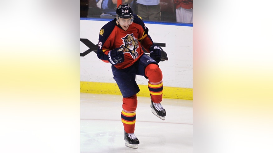 Florida Panthers' Tomas Fleischmann celebrates after scoring his 100th career goal, during the third period of an NHL hockey game against the Pittsburgh Penguins, Tuesday, Feb. 26, 2013, in Sunrise, Fla. The Panthers won 6-4. (AP Photo/Luis M. Alvarez)