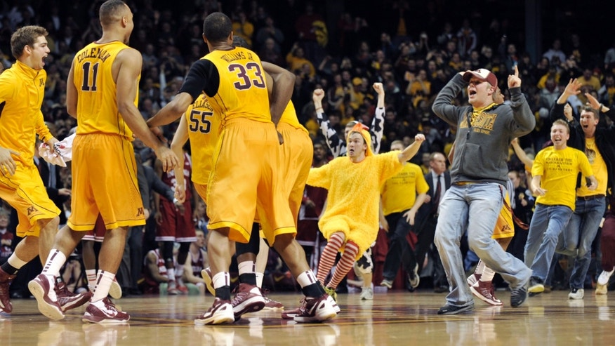 Fans rush the court after Minnesota defeated Indiana 77-73 in an NCAA college basketball game, Tuesday, Feb. 26, 2013, in Minneapolis. (AP Photo/Tom Olmscheid)