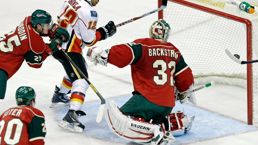 Calgary Flames' Jarome Iginla (12) watches as teammate Alex Tanguay's goal goes into the net against Minnesota Wild goalie Niklas Backstrom of Finland in the first period of an NHL hockey game Tuesday, Feb. 26, 2013, in St. Paul, Minn. At left is Wild's Jonas Brodin. (Photo/Jim Mone)
