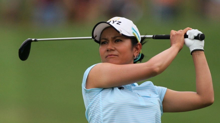 Ai Miyazato of Japan plays a shot from a fairway during the third round of the LPGA Thailand golf tournament in Pattaya, southern Thailand, Saturday, Feb. 23, 2013. (AP Photo/Sakchai Lalit)