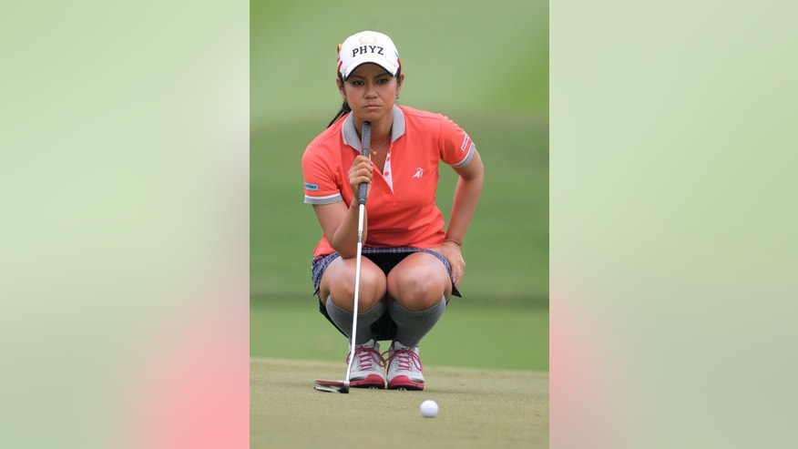 Ai Miyazato, of Japan, lines up for a putt during the final round of the LPGA Thailand golf tournament in Pattaya, southern Thailand, Sunday, Feb. 24, 2013. (AP Photo/Sakchai Lalit)