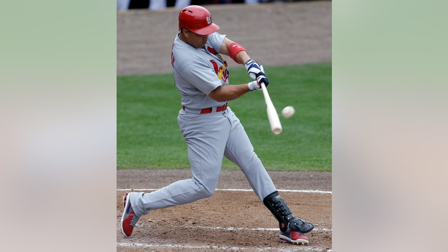 St. Louis Cardinals' Carlos Beltran hits a double during the third inning of an exhibition spring training baseball game against the New York Mets, Wednesday, Feb. 27, 2013, in Port St. Lucie, Fla. (AP Photo/Julio Cortez)