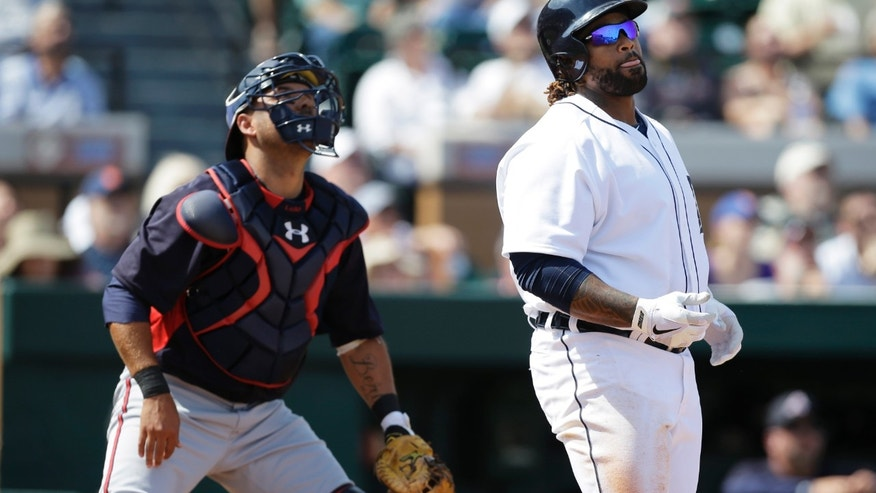 Detroit Tigers' Prince Fielder, right, watches his two-run home run in front of Atlanta Braves catcher Gerald Laird during the first inning of an exhibition spring training baseball game, Wednesday, Feb. 27, 2013, in Lakeland, Fla. (AP Photo/Charlie Neibergall)