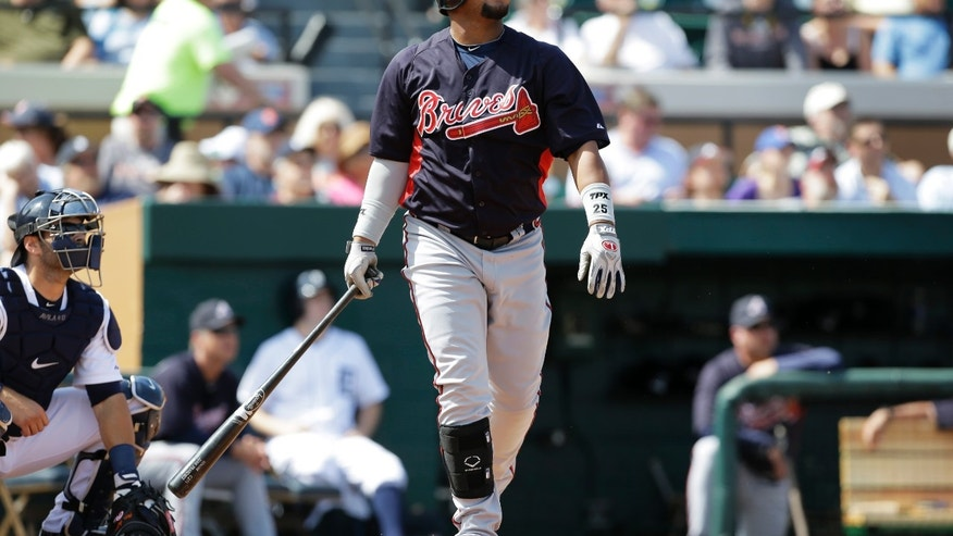 Atlanta Braves' Juan Francisco watches his three-run home run during the first inning of a baseball spring training exhibition game against the Detroit Tigers, Wednesday, Feb. 27, 2013, in Lakeland, Fla. (AP Photo/Charlie Neibergall)