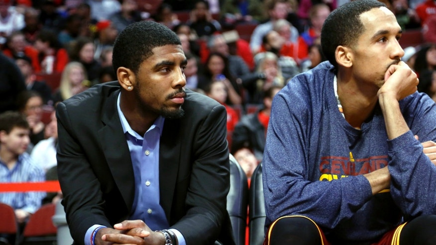 Cleveland Cavaliers' Kyrie Irving watches an NBA basketball game against the Chicago Bulls, Tuesday, Feb. 26, 2013, in Chicago. Irving sat the game out to rest his sore right knee. (AP Photo/Charles Cherney)