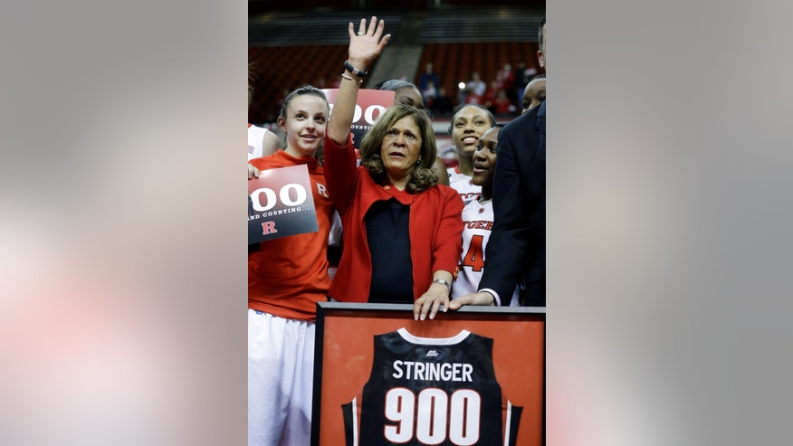 Rutgers head coach C. Vivian Stringer celebrates her 900th win after defeating South Florida 68-56 in an NCAA college basketball game Tuesday, Feb. 26, 2013, in Piscataway, N.J., . (AP Photo/Mel Evans)